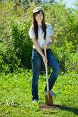 Woman gardening with spade in garden — Stock Photo