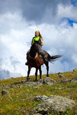 Lone rider on horseback — Stock Photo