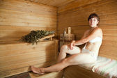 Woman sitting at sauna — Stock Photo