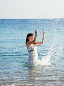 Happy woman in sea wave — Stock Photo