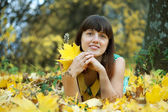 Young brunette woman in autumn — Stock Photo