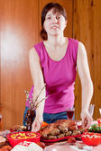 Woman serving Easter table — Stock Photo