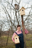 Woman with new birdhouses — Stock Photo