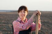 Female farmer in plowed field — Stock Photo