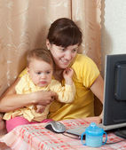 Woman with baby working with computer — Stock Photo