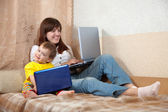Happy woman and child with laptops — Stock Photo