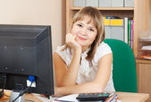Blonde businesswoman in office room — Stock Photo