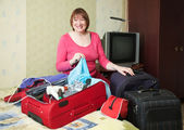 Woman packing Suitcase at home — Stock Photo