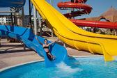 Girl in water slide at aquapark — Stock Photo