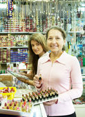 Two women buying cosmetic — Stock Photo