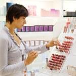 Woman chooses the cosmetics — Stock Photo #9904158