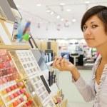 Girl buying cosmetic — Stock Photo