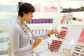 Woman chooses the cosmetics — Stock Photo