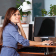 Woman in office using computer — Stock Photo #9911350