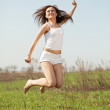 Jumping mid adult woman — Stock Photo #9911354