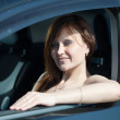 Woman is driving her car - Stockfoto