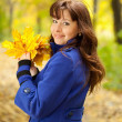 Woman with maple posy — Stock Photo