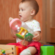 Year-old child with toys — Stock Photo