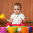 Year-old child with toys — Stock Photo #9912056