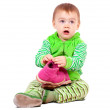 Child holding shoes over white — Stockfoto