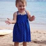 Little girl on sand beach — Stock Photo #9912120