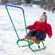 Toddler on sled in winter — Stock Photo #9912128