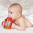 Baby girl with sippy cup — Stock Photo #9912131