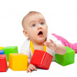 Baby girl plays with toy block — Stock Photo