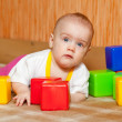 Royalty-Free Stock Photo: Girl plays with toy blocks