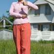 Happy womin front of new home — Stock Photo #9912323