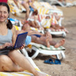 Ha ppy mature woman with laptop at resort — Stock Photo