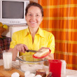Stock Photo: Womadds margarine into dough