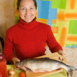 Mature woman with red fish — Stock Photo #9912398