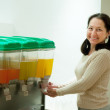 Woman pours juice from container — Stock Photo