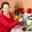 Mature woman brews herbs — Photo