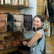 Woman chooses leather chest at shop — Stock Photo #9912481
