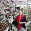 Woman chooses souvenirs in egyptian shop — Stock Photo #9912484