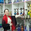 Woman chooses sheesha in shop — Stock Photo #9912485