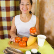 Woman with food products for farci tomato salad — Stock Photo #9912490