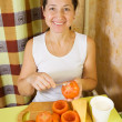 Woman making stuffed tomato — Stock Photo #9912493