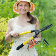 Female gardener with garden tools — Stock Photo