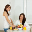Women have tea in kitchen — Stock Photo #9912682