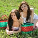 Women relaxing outdoor in grass — Stock Photo