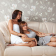 Women lying  with TV Remote control — Stok fotoğraf