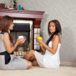 Women near the fireplace — Stock Photo #9912695