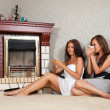 Women near the fireplace — Stock Photo #9912697