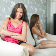 Stock Photo: Women after quarrel at home