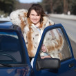 Happy woman with her car — Stock Photo