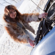 Woman repairing her car outdoor — Stock Photo