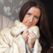 Portrait of woman in fur coat — Стоковое фото